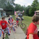 kids on decorated bikes